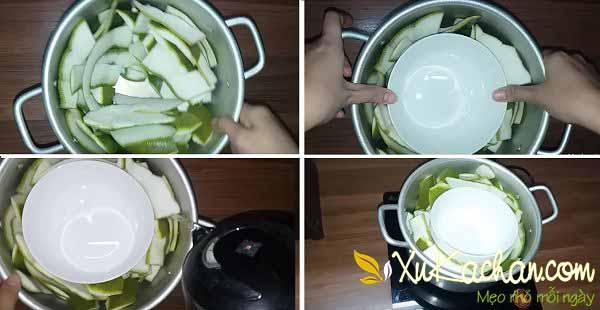 Đun nguyên liệu - cách làm tinh dầu bưởi tại nhà